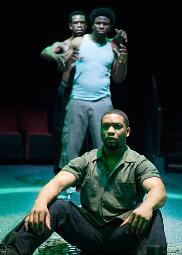 "Joshua Elijah Reese as Ogun Henri Size (foreground) and (background, from left) Antwayn Hopper as Elegba and Okieriete Onaodowan as Oshoosi Size in the Southern California premiere of Tarell Alvin McCraney's ""The Brothers Size,"" directed by Tea Alagić, Jan. 26 - Feb. 24, 2013 at The Old Globe. Photo by Henry DiRocco."