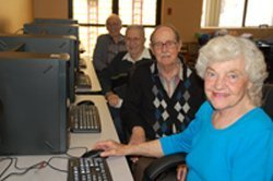 Guests enjoying the lab at College Avenue Cyber Cafe. Courtesy image of College Avenue Center.