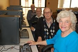 Guests enjoying the lab at College Avenue Cyber Cafe. Cou...