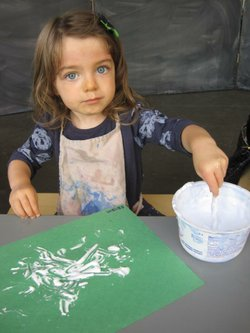 Image of a little girl attending a previous Finger Painting Friday at the New Children's Museum. Courtesy of the New Children's Museum.
