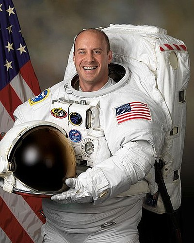 Official portrait image of NASA astronaut Garrett Reisman...