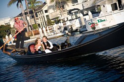 Promotional photo of a couple sharing a Gondola ride in Coronado.