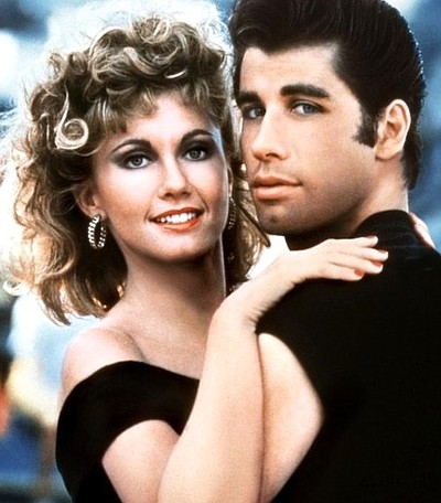 Image of Sandy (Olivia Newton-John) and Danny (John Travolta) in the film, Grease.