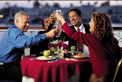 Two couples toast on a Hornblower Cruise. Courtesy of Hornblower Cruises & Events.