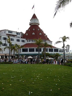 Promotional image of the Hotel Del Coronado's Windsor Lawn filled with Easter eggs.