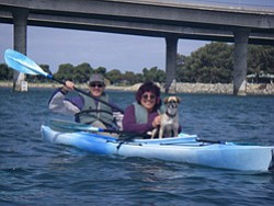 Promotional image of a happy couple participating in one of Family Kayak Adventure Center's kayak tours.