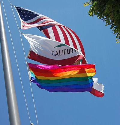 Promotional image of LGBT flag-raising at San Diego State University on Wednesday, July 10, 2013.