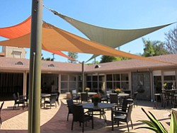 Promotional image of La Jolla Community Center courtyard.