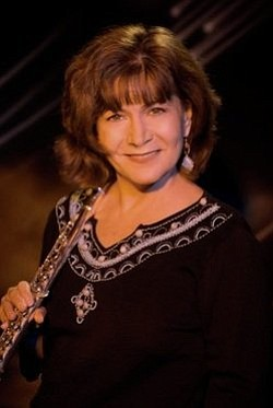 Image of flutist, Lori Bell, who will be performing at The Cosmo on April 13th, 2013. Photo by Michael Oletta.