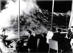 Promotional 1949 photograph of waves crashing up on the windows of the Marine Room. Courtesy image of Marine Room.