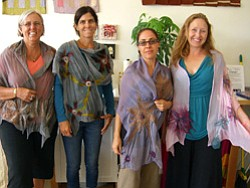 Promotional image of Bravo School of Art students and their Nuno Felted Scarf.