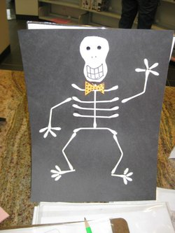 Promotional graphic for the arts and crafts stations at the North University Community Library's Halloween Carnival.
