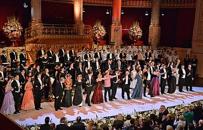 "The cast, including the world-famous Vienna Boys' Choir, perform the grand finale, ""Champagne Is King"" from the operetta ""Die Fledermaus"" at the Konzerthaus in Vienna, Austria. (KPBS photo)"