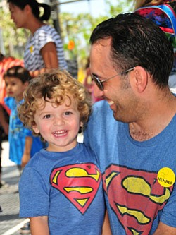 Promotional image of Superheroes' Night Out at the New Children's Museum on July 27, 2013.