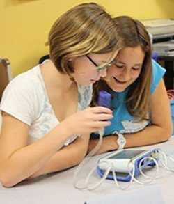 Image of girls attending the Science Saturday Girls Club. Courtesy of Reuben H. Fleet Science Center.