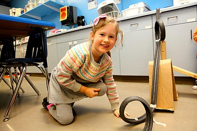 "Image of a child playing in the ""Tinkering Studio"" at The Fleet. Courtesy of The Reuben H. Fleet Science Center."