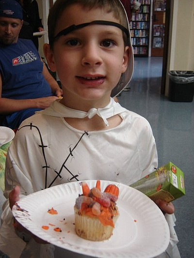 Photo of a child attending a previous year's Halloween Art, Music, And Storytelling event at the University Community Branch Library.