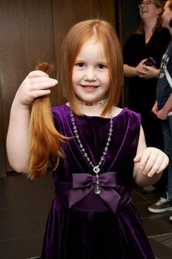 "Promotional image of a young girl participating in Disney On Ice's / ""Dare To Dream"" Hair Donation taking place in San Diego on Saturday, January 12 from noon to 4:00 p.m."