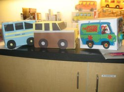 Promotional image of hand crafted buses for Rosa Park's 100 birthday at City Heights Library.