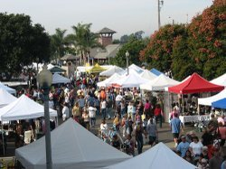 Image of patrons visiting the vendors' booths at the annual Carlsbad Village Street Faire.