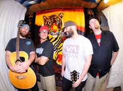 Promotional photo of the reggae rock band, The Expendables.