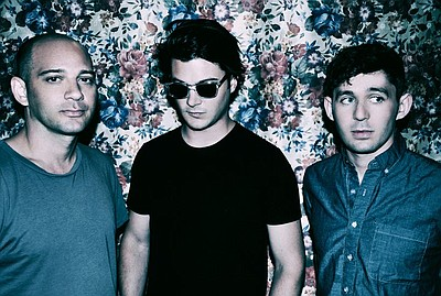 Promotional photo of indie group, The Antlers.