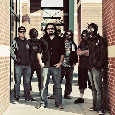 Promotional photo of reggae group, Stranger.