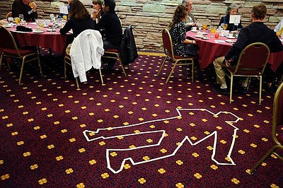 Photo of a previous Dinner Detective Murder Mystery Show. Courtesy of The Dinner Detective.