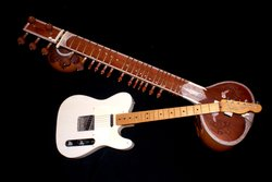 Promotional image of an older style guitar side-by-side with a newer Fender style. Courtesy of the Reuben H. Fleet Science Center.