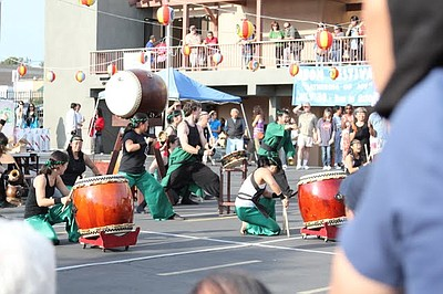 Promotional photo of taiko drumming groups at an Obon fes...