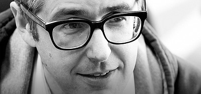 "Promotional photo of Ira Glass, host of ""This American Life."" Courtesy of Stuart Mullenberg"