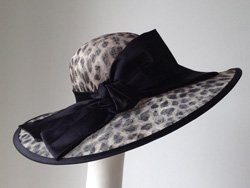 Promotional graphic of a hat from Jill Courtemanche Millinery.