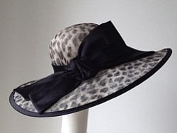 Promotional graphic of a hat from Jill Courtemanche Milli...