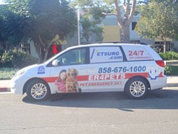 Promotional photo of PETSURG & ER4PETS van outside the cl...