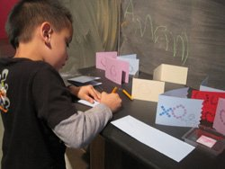 Promotional photo of a child participating in VONS Handmade Holidays, DIY Valentines at the New Children's Museum.