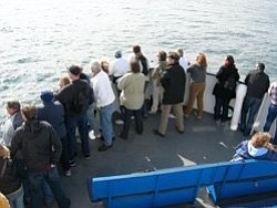 Promotional photo of guests on a whale watching expedition. Courtesy of Birch Aquarium at Scripps & Flagship Flagship Cruises & Events