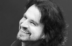 Promotional photo of composer/performer Yanni. Courtesy of Whit Padgett