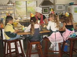 Promotional image of youth cooking at The Center for a Healthy Lifestyle's Youth Culinary Academy. Courtesy image of The Center for a Healthy Lifestyle.