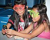 Two girls having a fun learning experience with the Reuben H. Fleet Science Center.