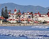 Promotional photo of Hotel del Coronado and Coronado Beach.