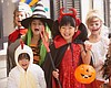 Promotional photo of children in great costumes for the Linda Vista Library Halloween Costume Contest.