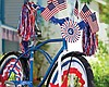 Promotional photo of a bike decorated in red, white and blue. Courtesy of Rancho San Diego Library