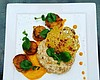 Promotional photo of a dish by Chef Lety: Brown Butter Seared Scallops, Citrus Risotto, Carrot Cardamom Puree, Asiago Bacon Dust Tuile, Petite Cress, & Fennel Pollen. Courtesy of Uptown Tavern