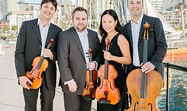 A photo of The Hausmann Quartet, a classical music group that will perform mu...