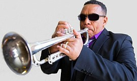 A photo of the frontman of the Cuban jazz group, Cubanismo!