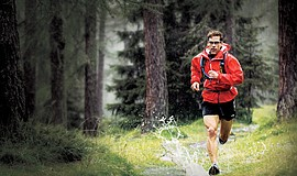 Promotional photo of Dean Karnazes running in the rain.
