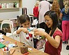 Promotional photo of guests having fun creating works of art. Courtesy of New Children's Museum