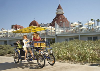 Promotional photo: family enjoys a bike ride at Hotel del...