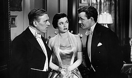 "Leo G. Carroll, Ruth Roman, and Robert Walker in ""Strangers on a Train."""