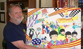 Photo of Ron Campbell with a Beatles drawing.